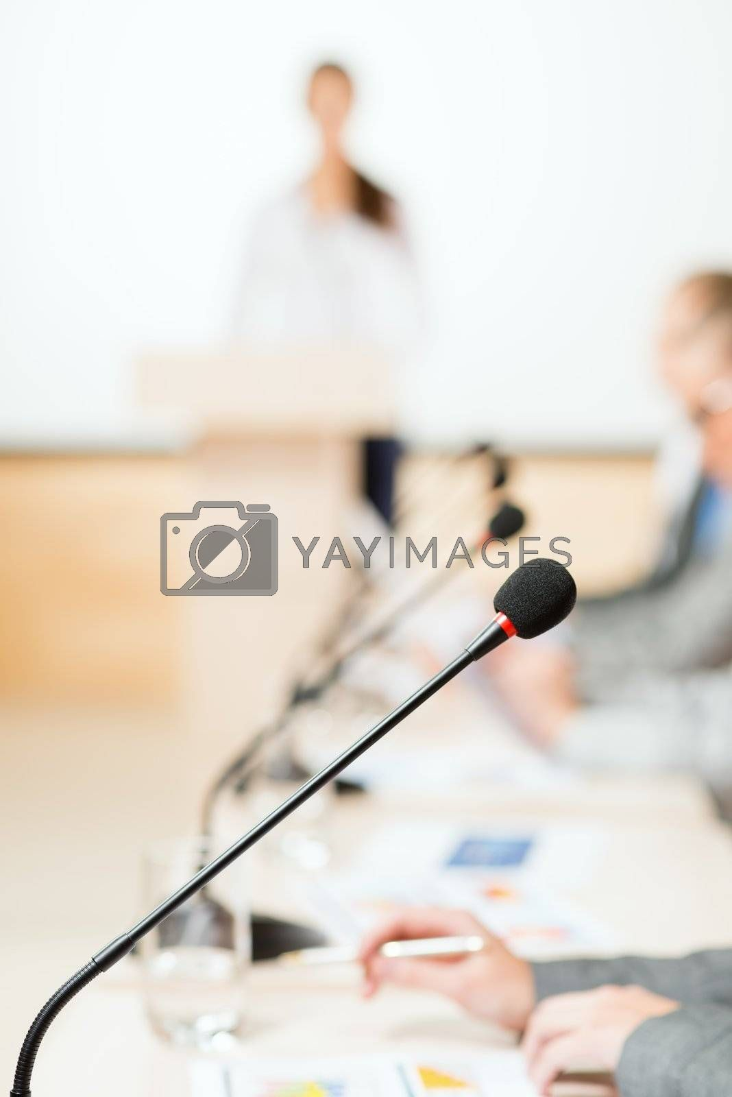 close-up microphone, on the background of business communication at the conference
