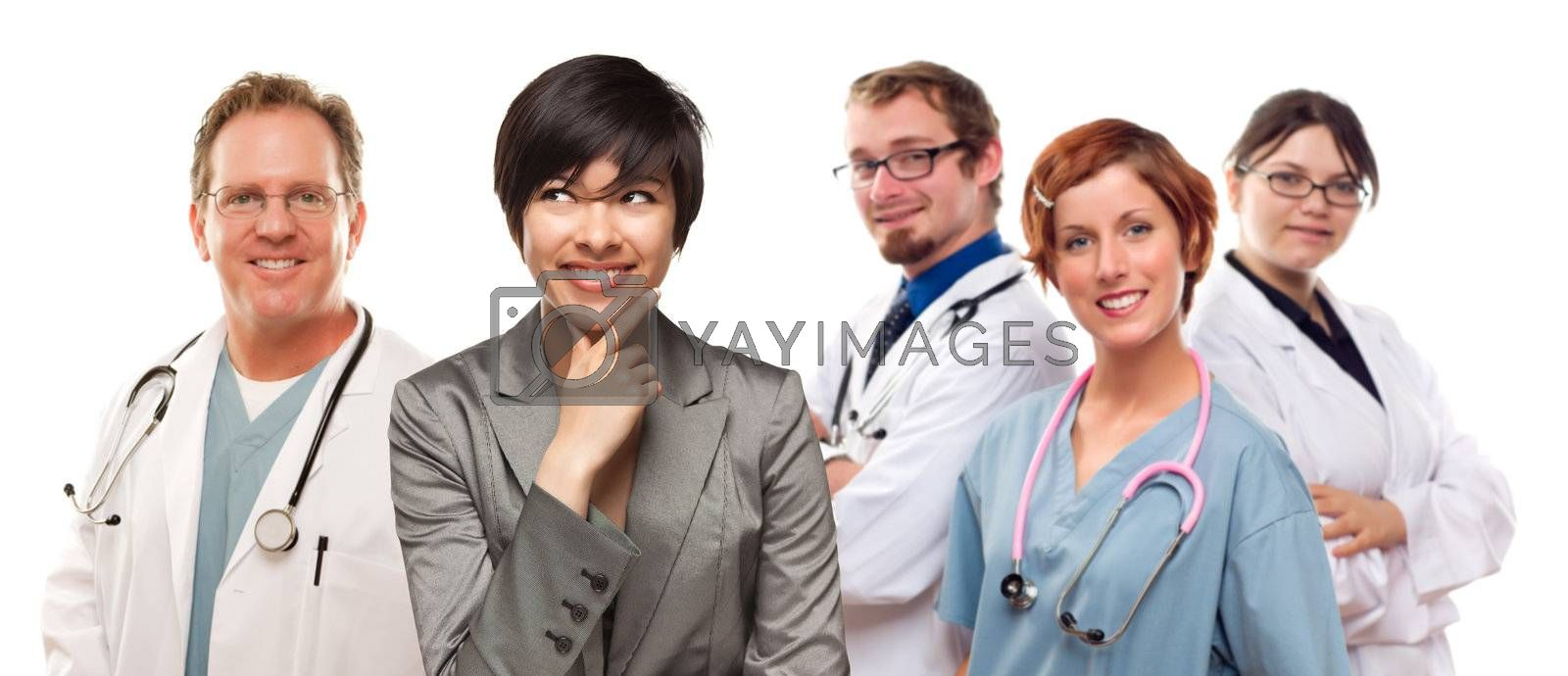 Young Mixed Race Woman with Doctors and Nurses Behind Isolated on a White Background.