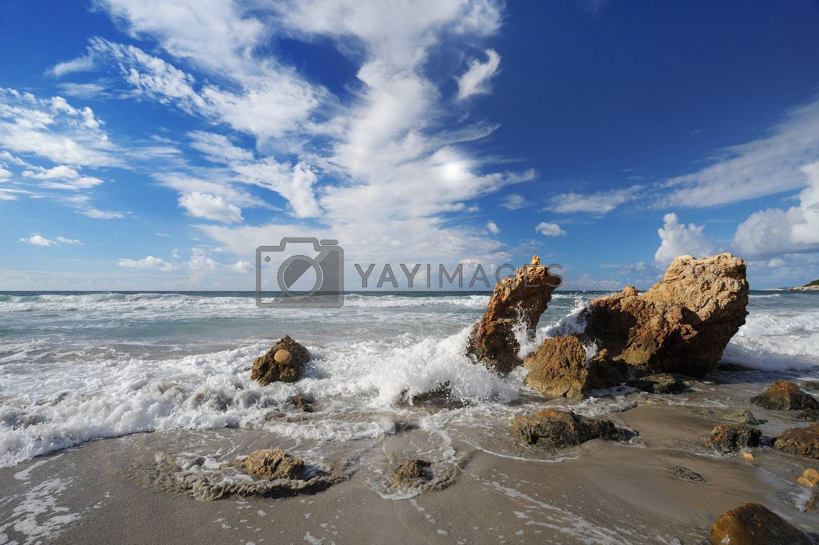 Landscape with sea and sand, white clouds in the sky