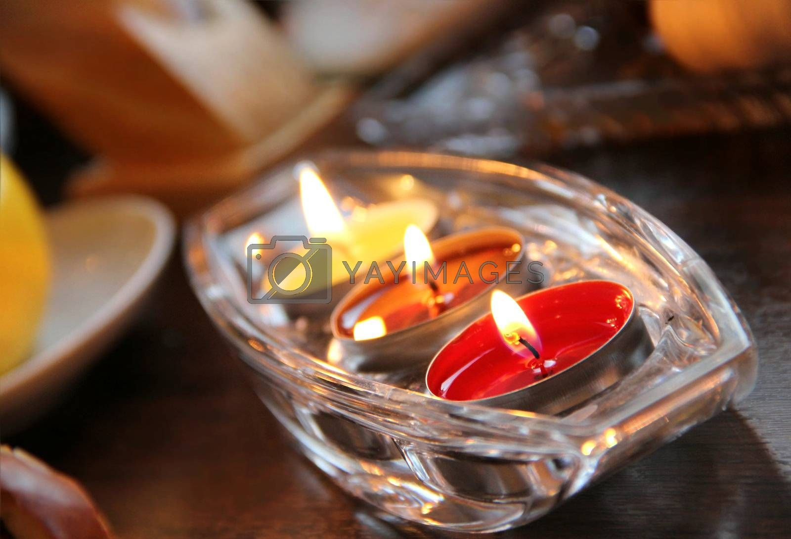 Three beautiful burning candles in the luxury crystal candlestick