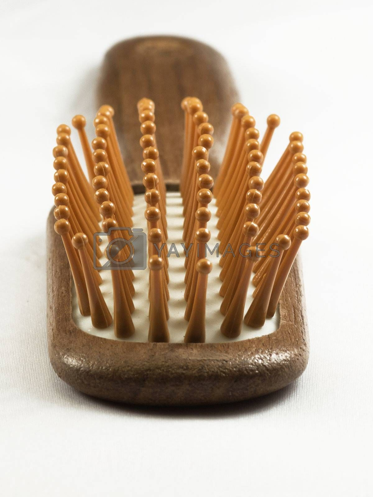 Wooden hair brush isolated on white background.
