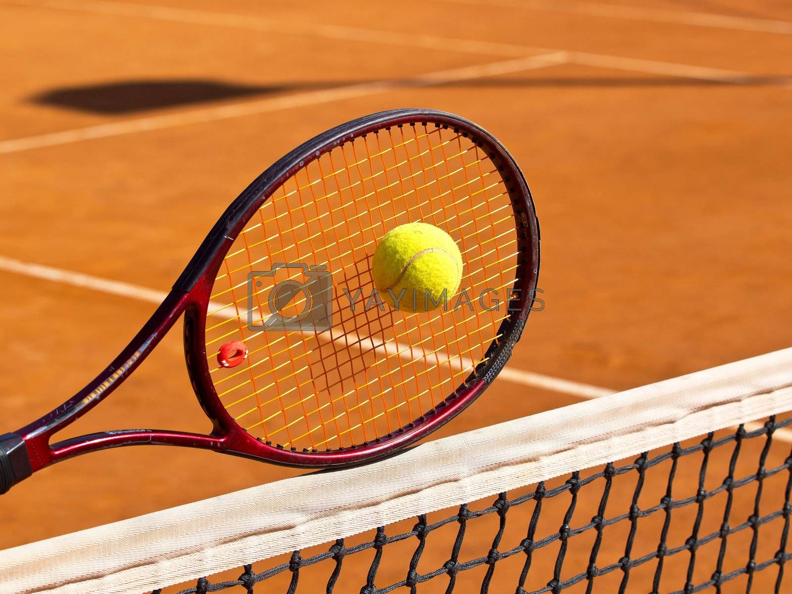 tennis racquet on the net in the middle of the tennis court