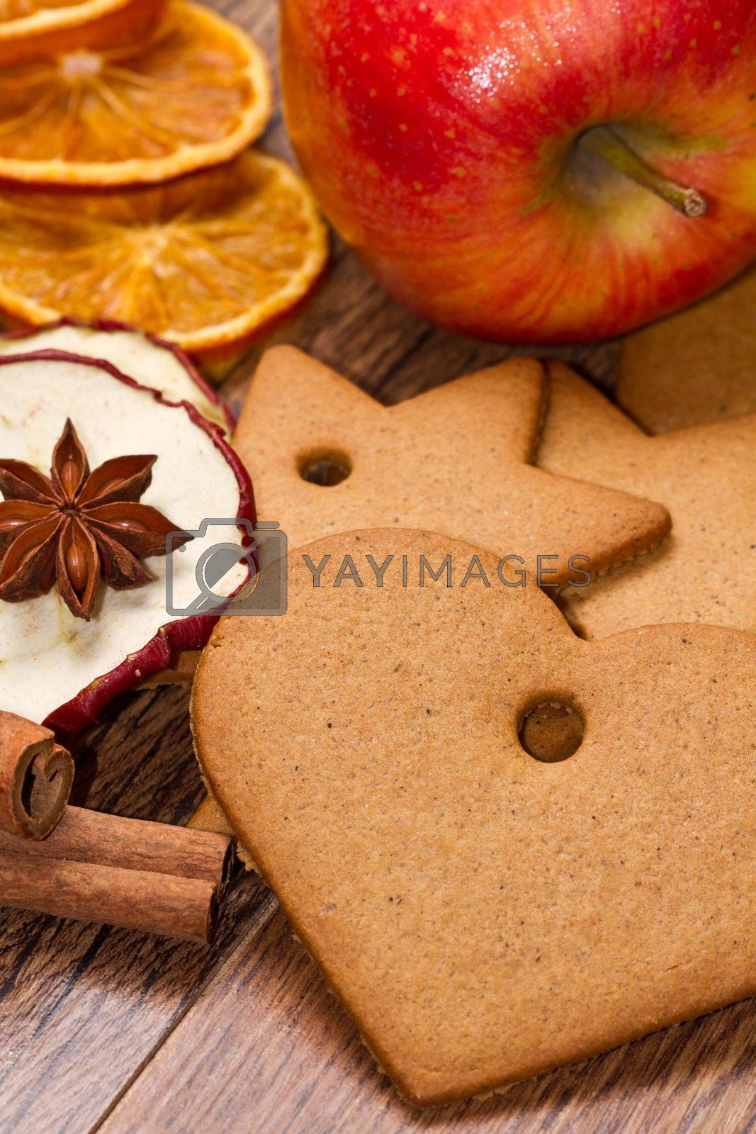 fresh apple with biscuit,cinnamon and fruit dried on wooden table