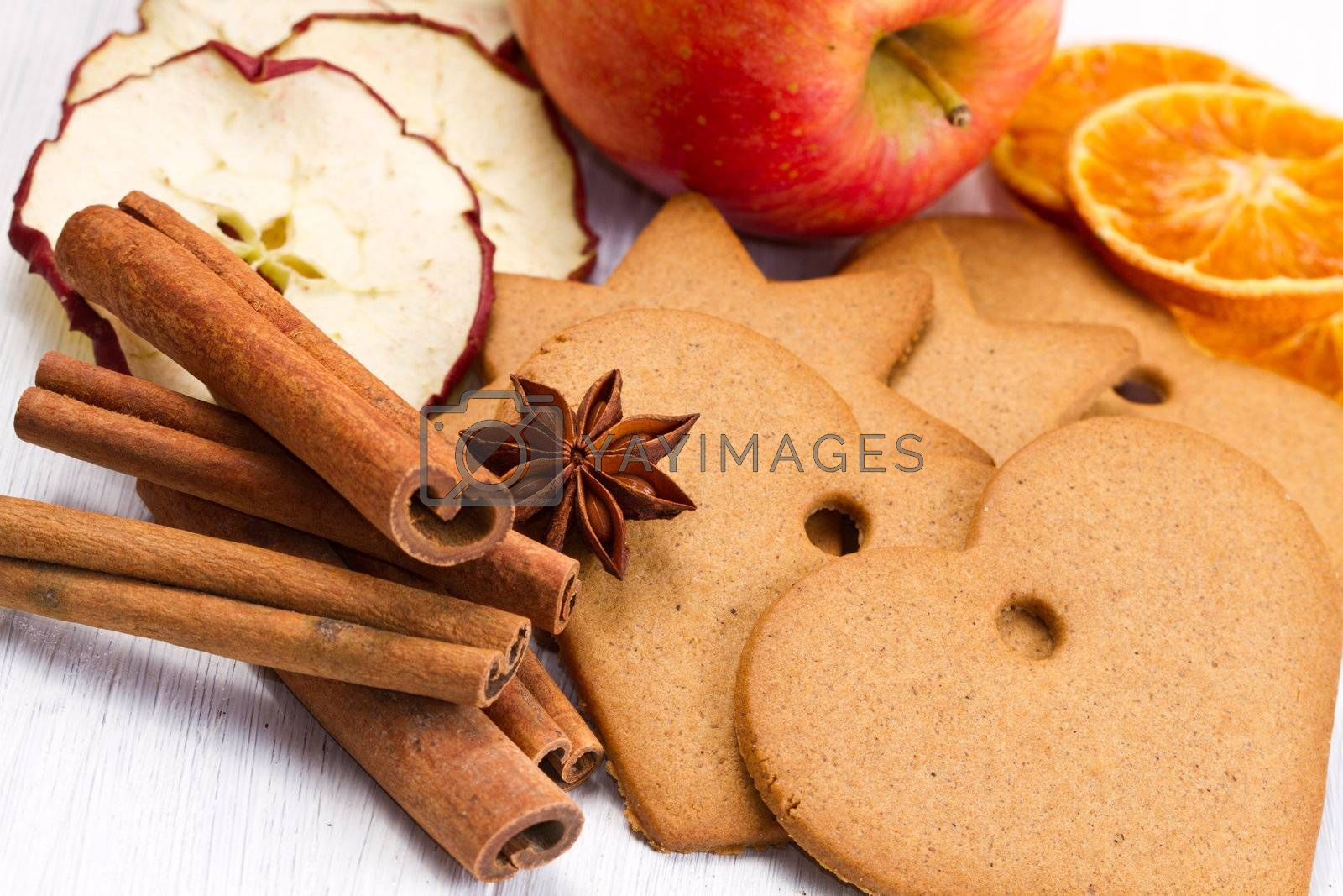 fresh apple with biscuit,cinnamon and fruit dried on white background