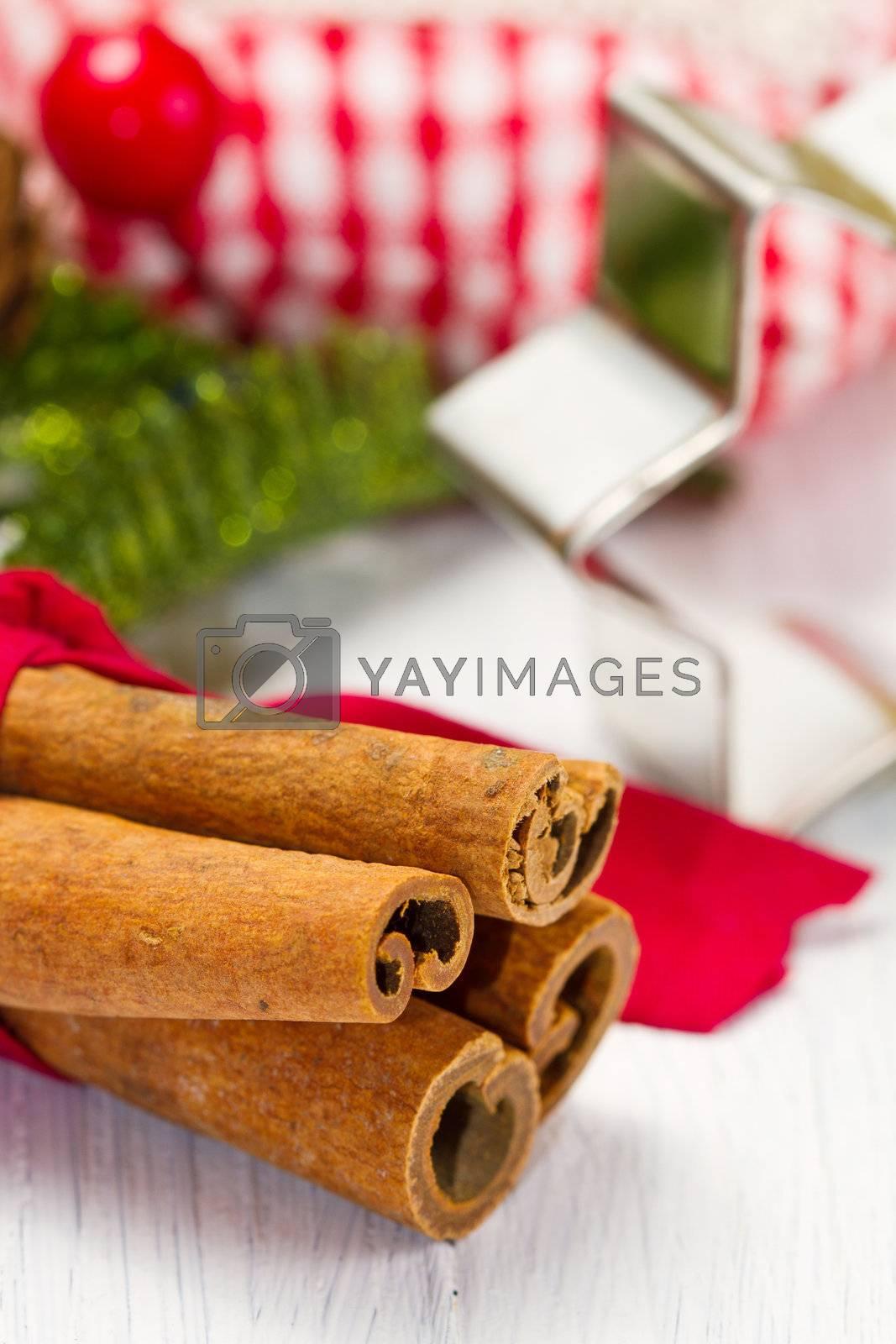 cinnamon sticks with decoration on white