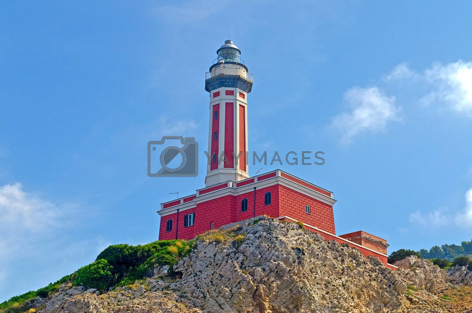 Red Lighthouse seen on the island of Capri, Italy, shot from a boat