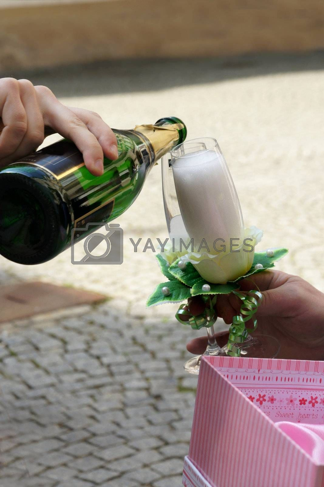 Bottle of Champagne and crystal glasses in the man hands