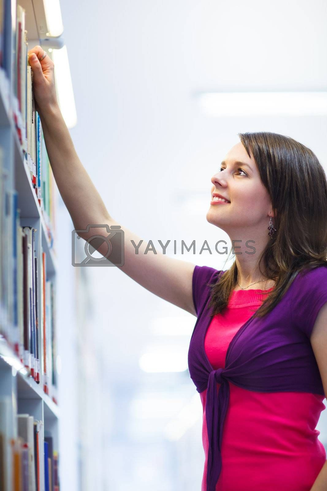 Pretty young college student in a library (shallow DOF; color to by Viktor Cap