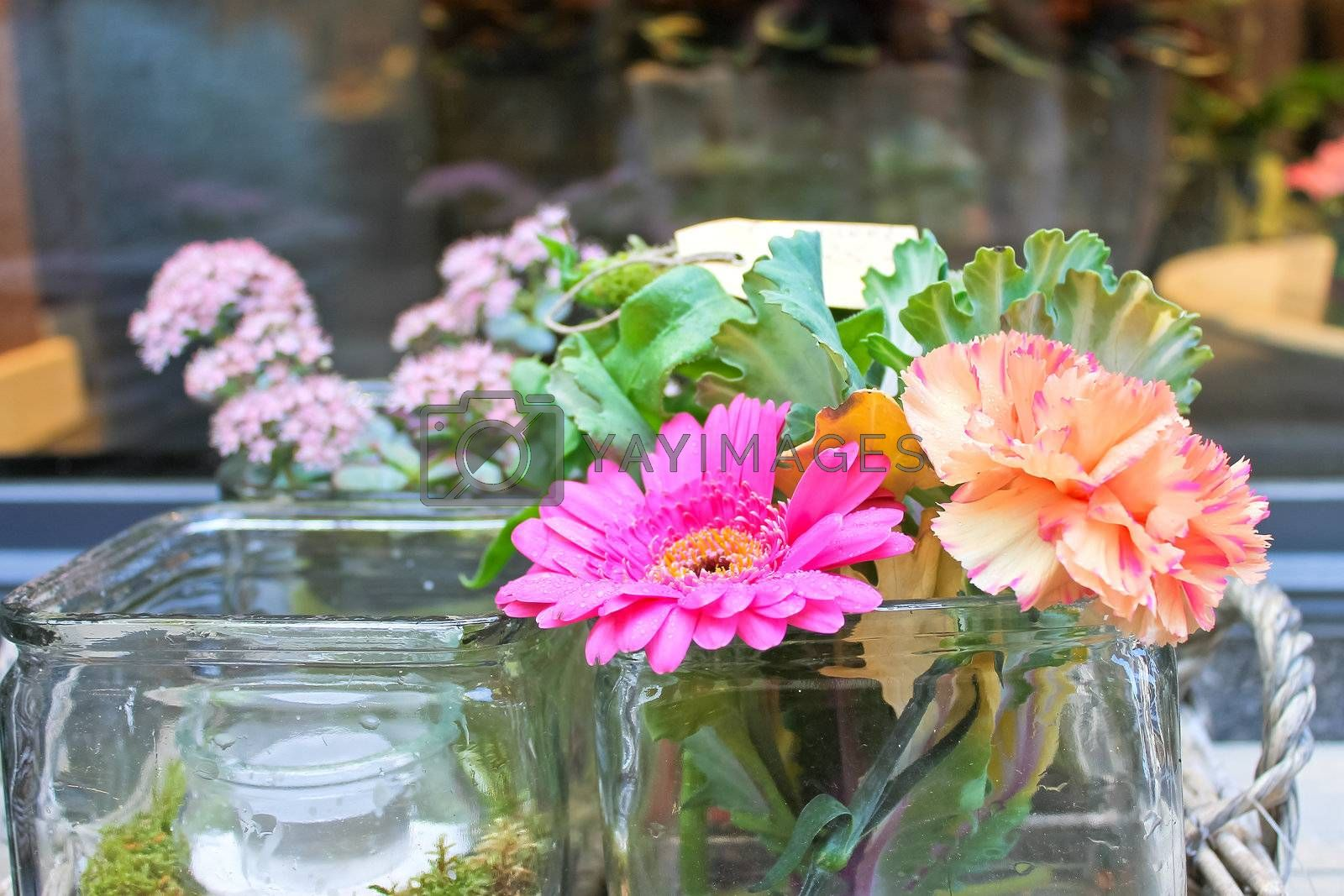 Flowers in a glass vase on the table
