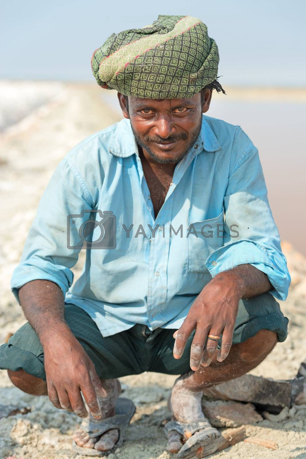 Sambhar, India - Nov 19: Portrait of indian male worker in salt farm on Nov 19, 2012 in Sambhar Salt Lake, India. It is India's largest saline lake and where salt has been farmed for a thousand years.