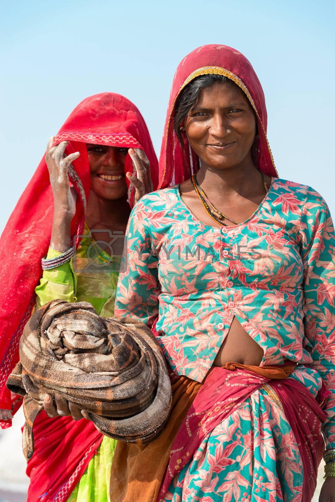 Sambhar, India - Nov 19: Portrait of indian female workers in salt farm on Nov 19, 2012 in Sambhar Salt Lake, India. It is India's largest saline lake and where salt has been farmed for a thousand years.