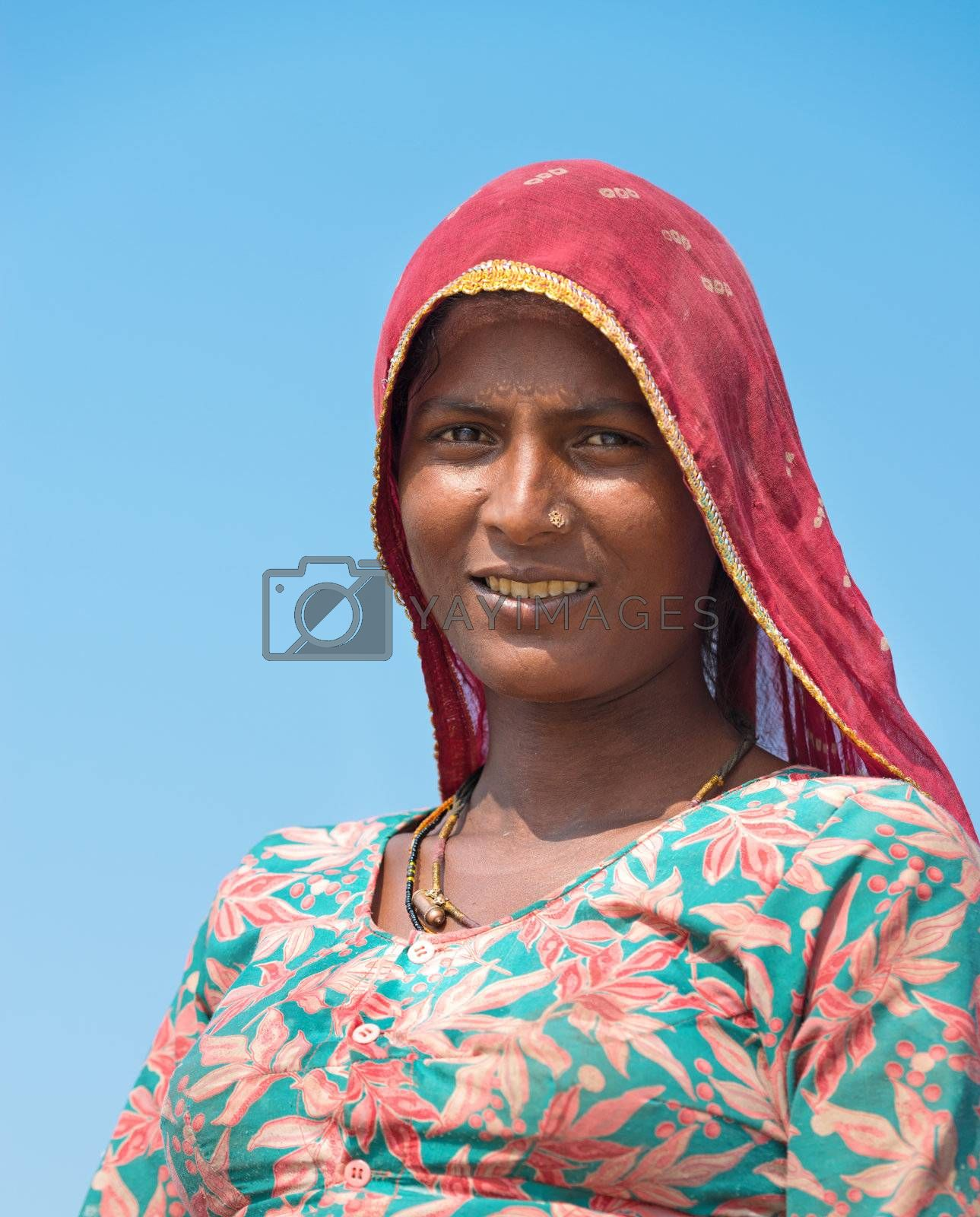 Sambhar, India - Nov 19: Portrait of indian female worker in salt farm on Nov 19, 2012 in Sambhar Salt Lake, India. It is India's largest saline lake and where salt has been farmed for a thousand years.
