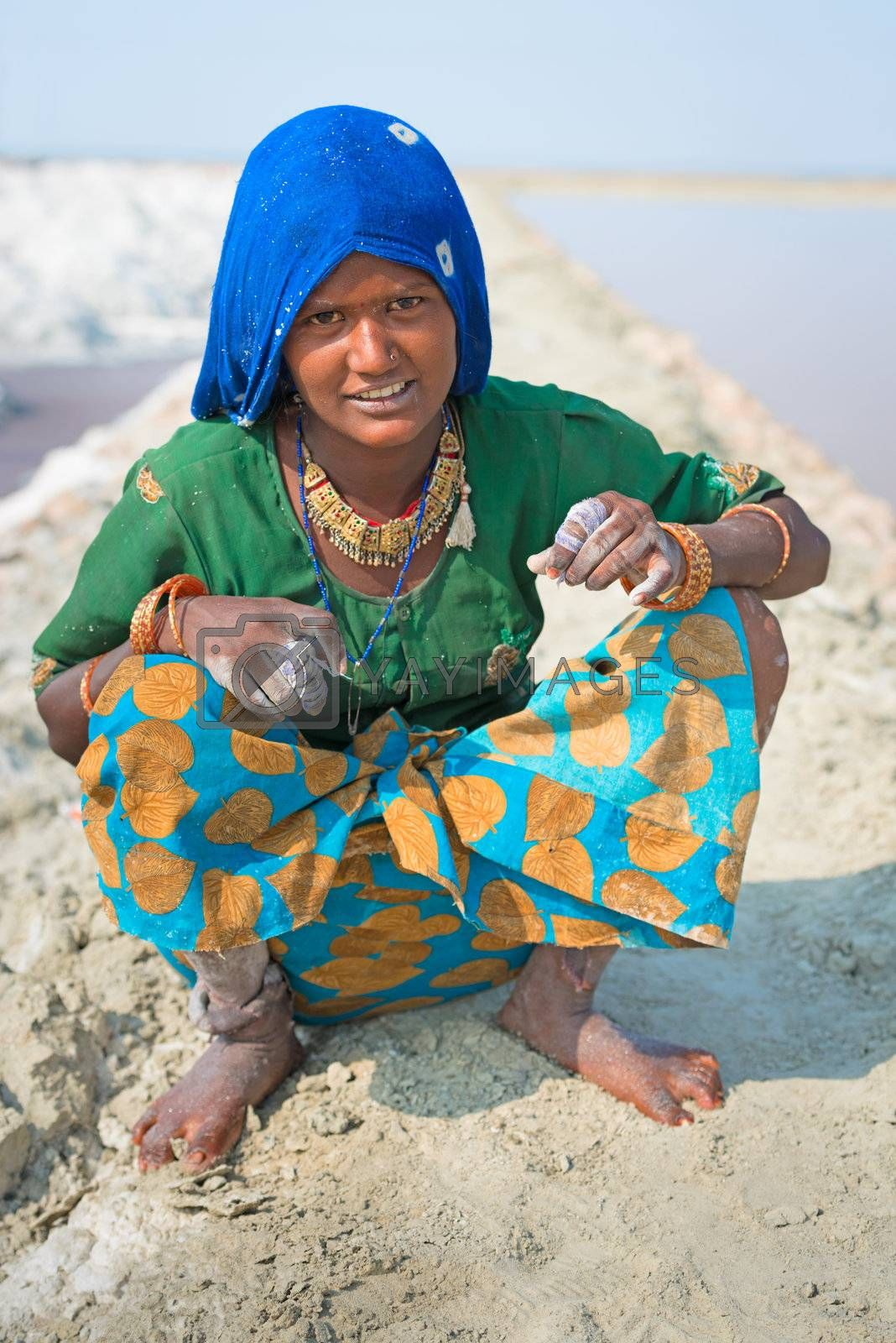 Sambhar, India - Nov 19: Portrait of indian female worker in salt farm on Nov 19, 2012 in Sambhar Salt Lake, India. It is India's largest saline lake, where salt has been farmed for a thousand years.