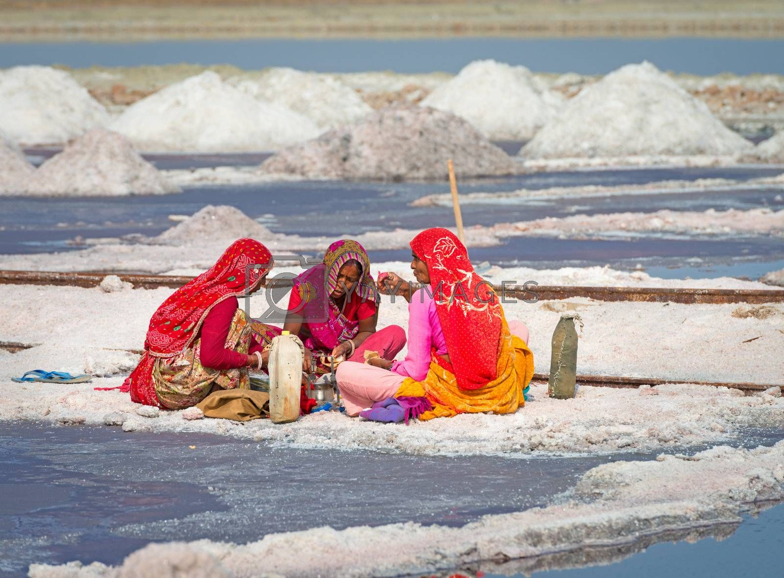 Sambhar, India - Nov 19: Workers take a lunch break in salt farm on Nov 19, 2012 in Sambhar Salt Lake, India. It is India's largest saline lake and and where salt has been farmed for a thousand years