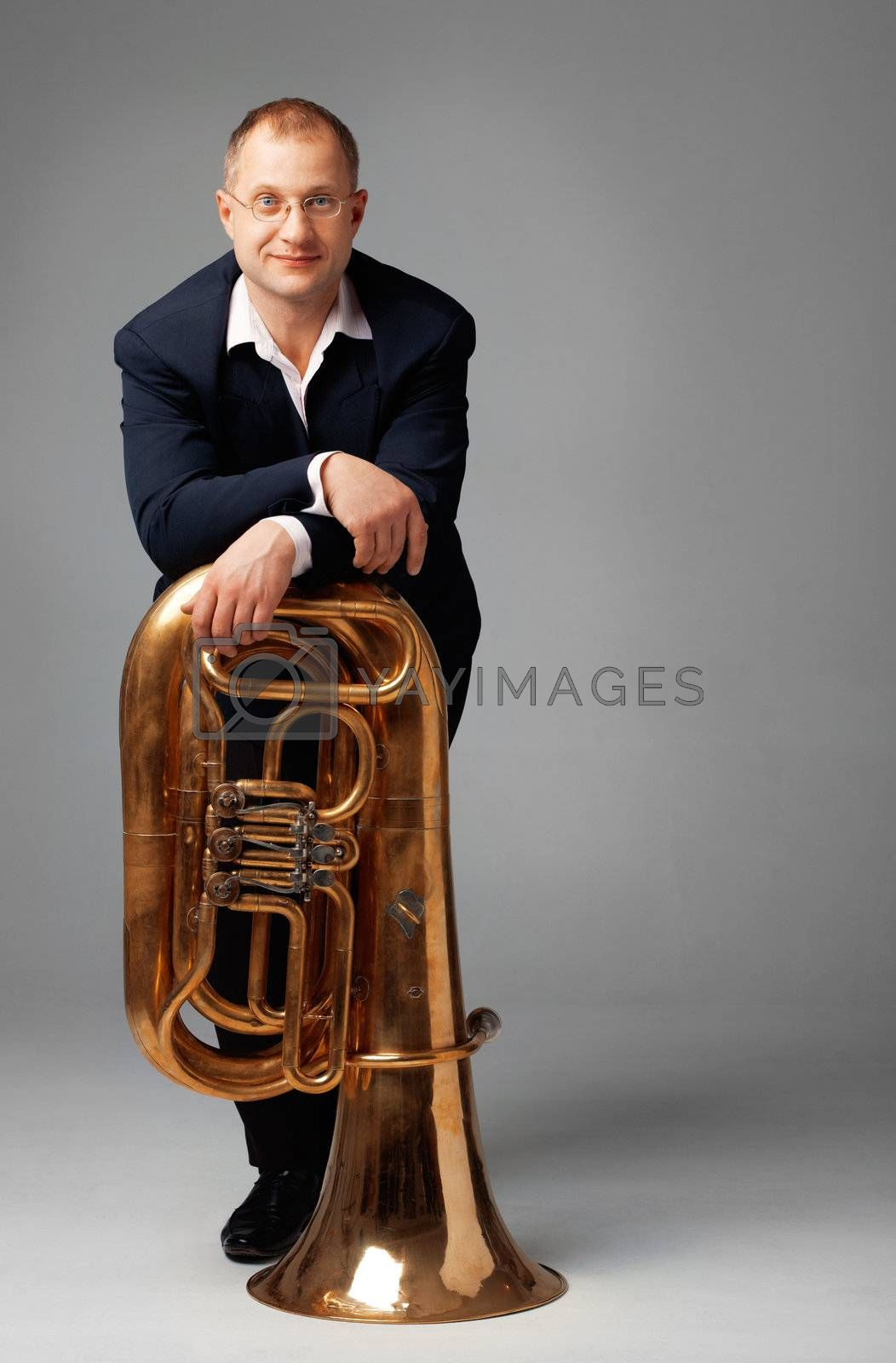 Portrait  of a young tubaist with his instrument