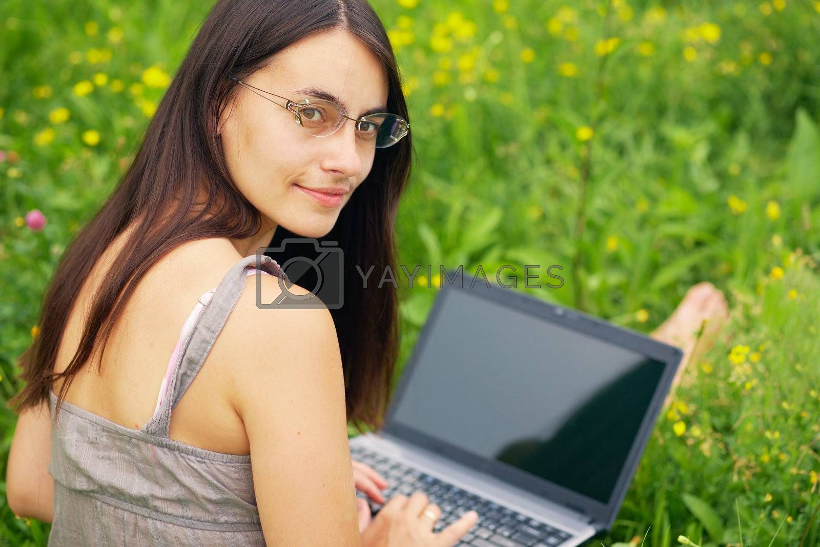 Close-up portrait of a woman with laptop outdoors