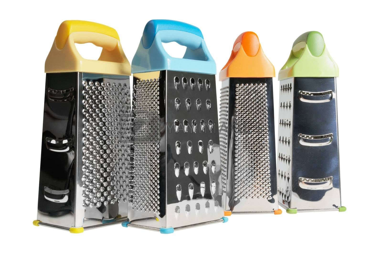 Kitchen grater different colors. Isolated on white.