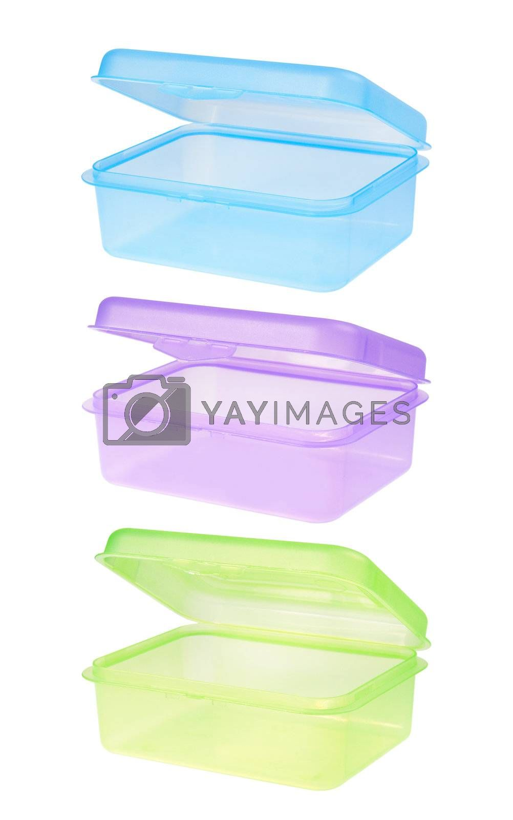 Plastic container for storing food. Blue, magenta and green. Isolated on white background