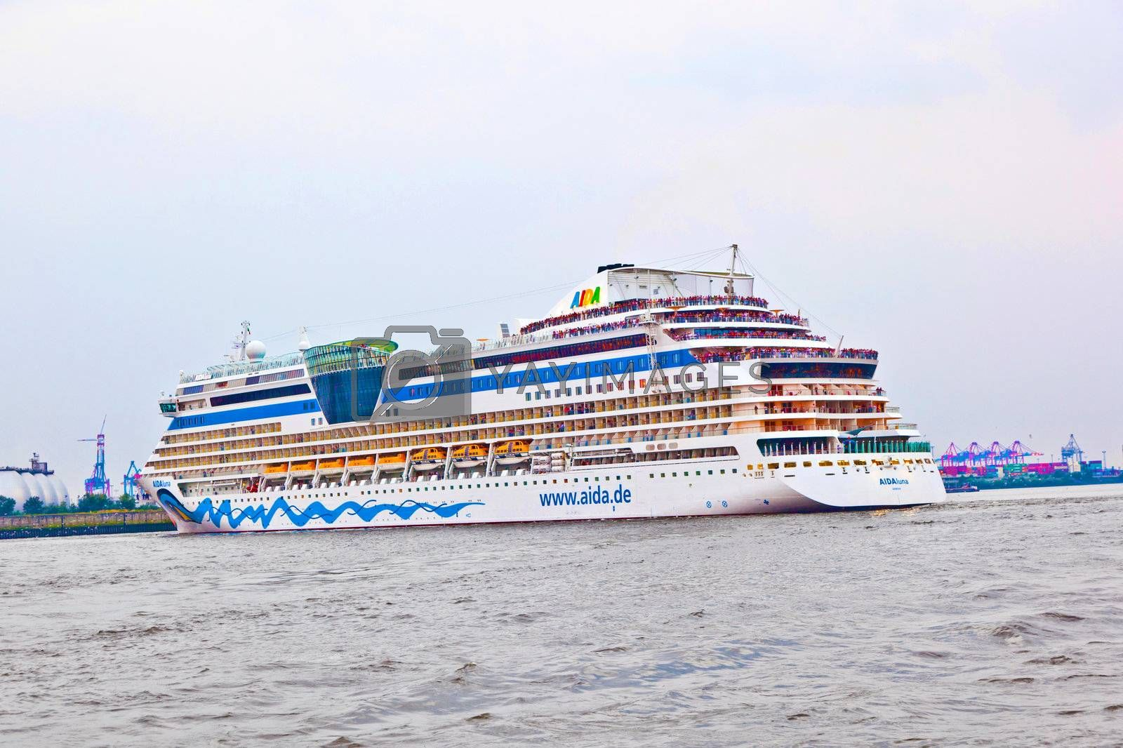 amous cruise liner AIDA leaves the harbor by meinzahn