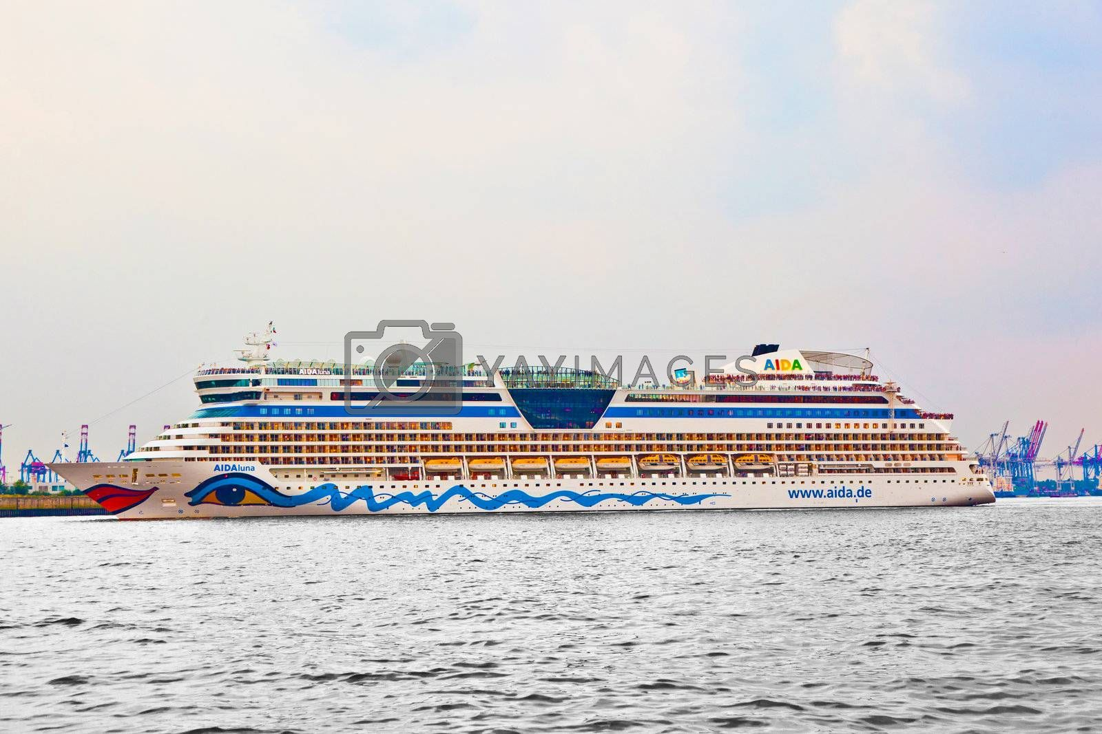 HAMBURG, GERMANY - 25 AUGUST: the famous cruise liner AIDA leaves the harbor at August 25, 2011 in Hamburg, Germany. AIDA Cruise Lines  carries more passengers than any other cruise line in the country.