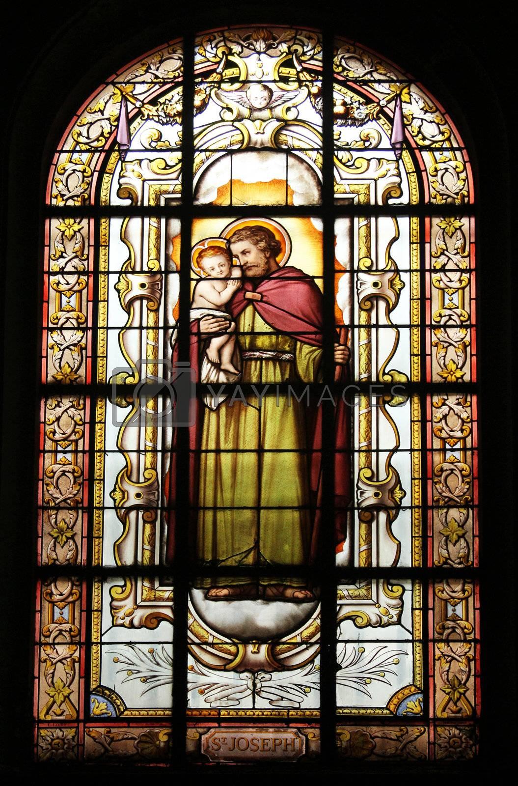 Saint Joseph holding baby Jesus, stained glass, St. Elizabeth of Hungary church, Paris