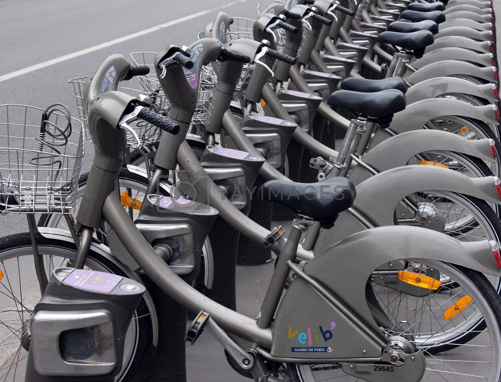 PARIS, FRANCE - NOVEMBER 07, 2012: Velib bycycles in the row on January 6, 2012 in Paris, France. Velib is a large-scale public bicycle sharing system in Paris, France.