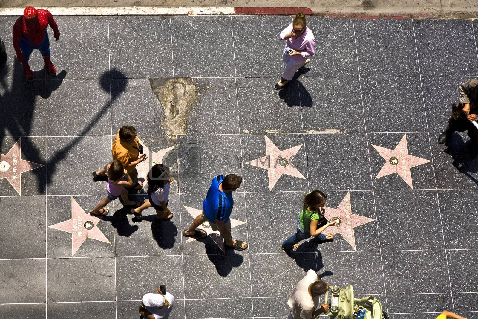 HOLLYWOOD, LOS ANGELES - JULY 5: people passing the walk of fame in Hollywood on a sunny day on July 5,2008, Los Angeles, USA