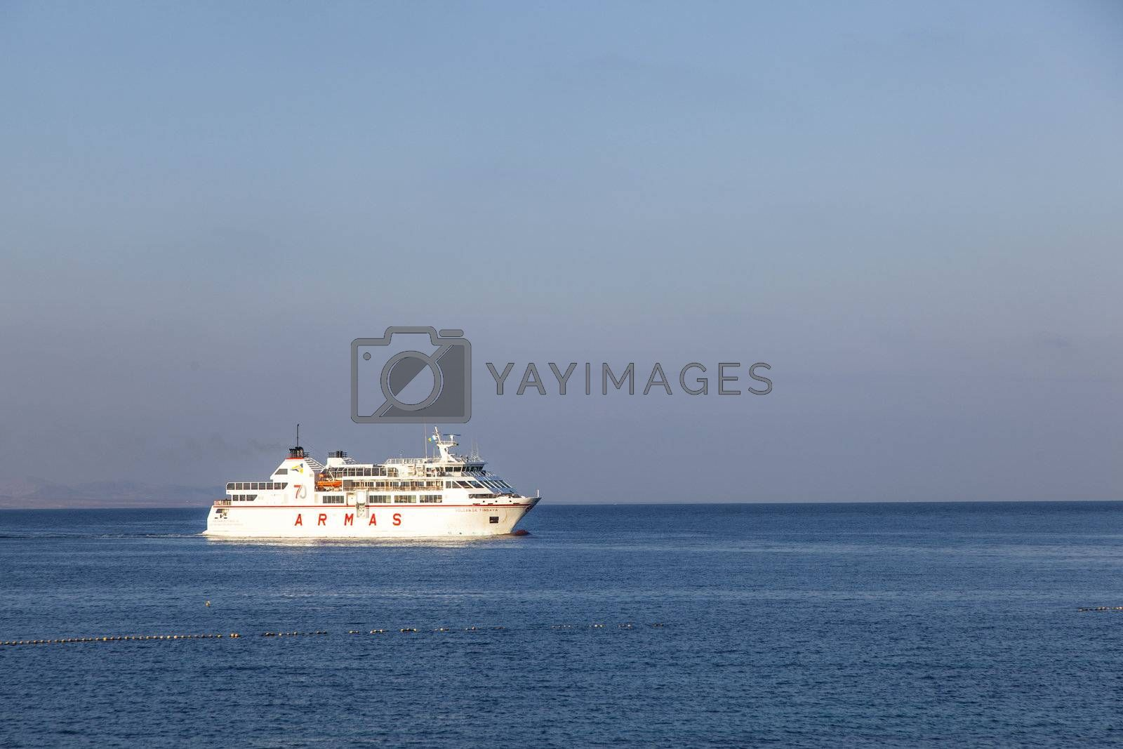 PLAYA BLANCA, SPAIN - APRIL 2: the ferry Volcan de Timanfaya ARMAS enters the harbor on April 02,2012 in Playa Blanca, Spain. It connects 6 times daily Lanzarote with Fuerteventura.
