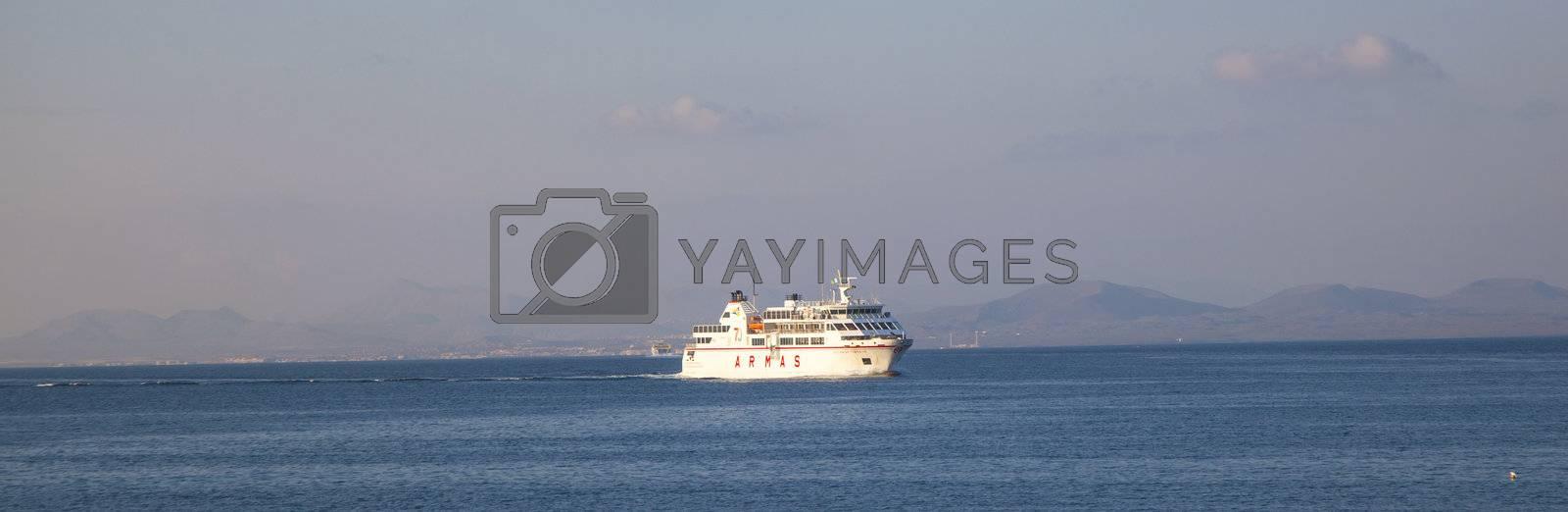 PLAYA BLANCA, SPAIN - APRIL 2: the ferry Volcan de Timanfaya ARMAS enters the harbor on April 02,2012 in Playa Blanca, Spain. It connects 6 times daily Lanzarote with Fuerteventura.