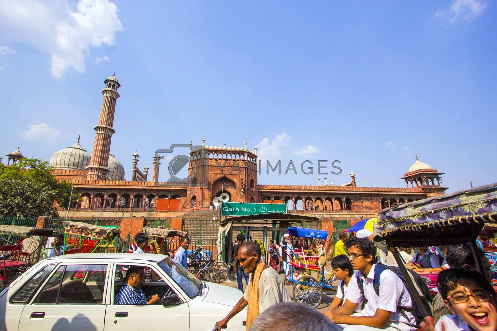DELHI, INDIA - OCTOBER 15: people enter the Jama Masjid throug gate No 1 on October 15, 2012 in Delhi, India. The mosque is surrounded by markets and  trafic.