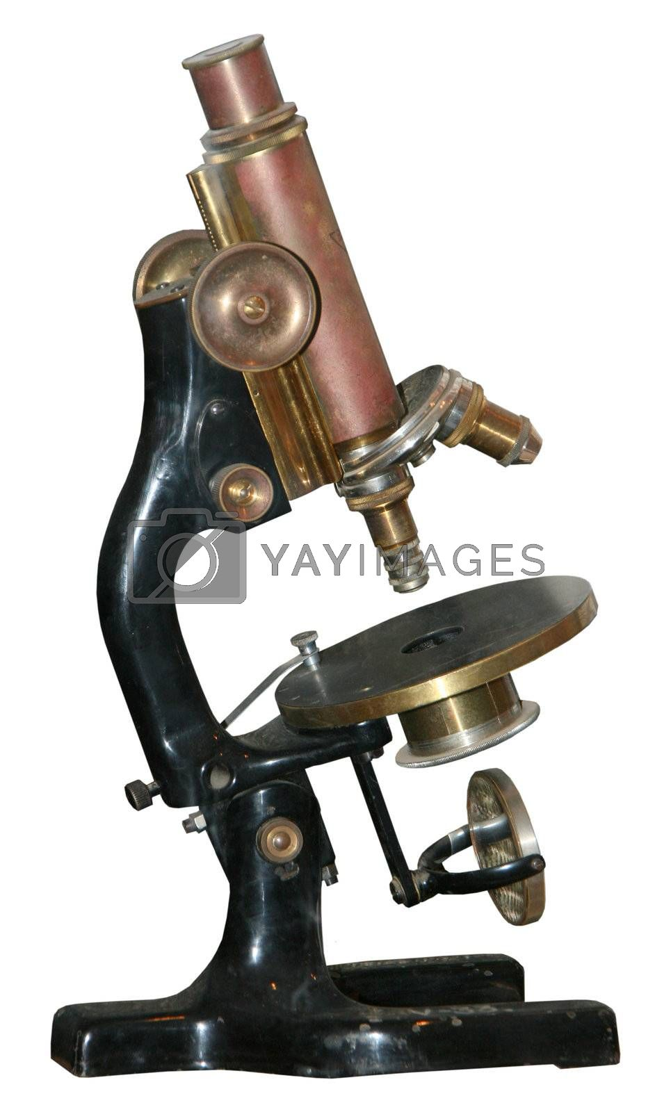 Isolated rusty obsolete vintage microscope on white background
