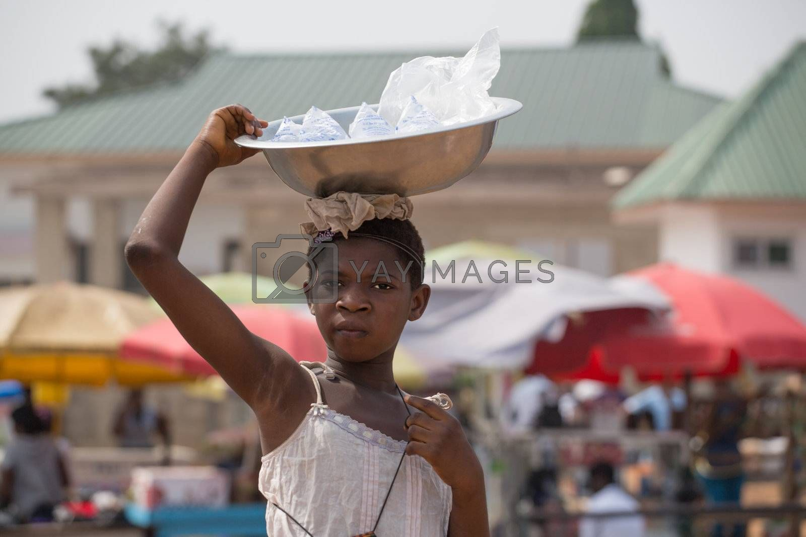 A little girl selling ice wrapped in plastic bags in Ghana