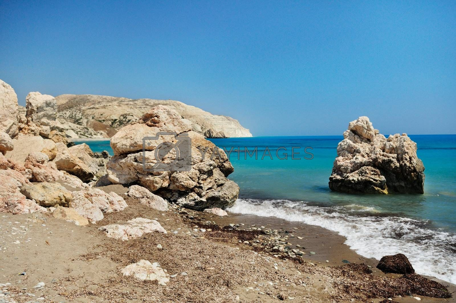 Rocky shore of the Mediterranean sea with clear water. Birthplace of Aphrodite. Cyprus.