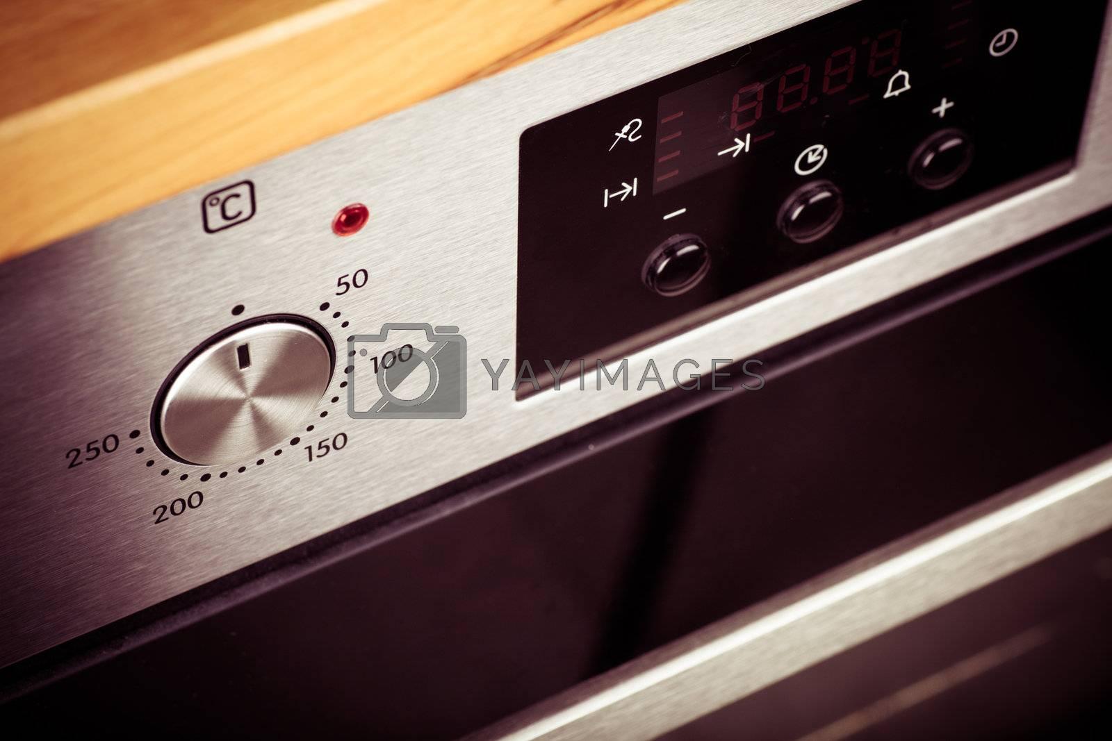 Closeup view of metallic handle of modern oven