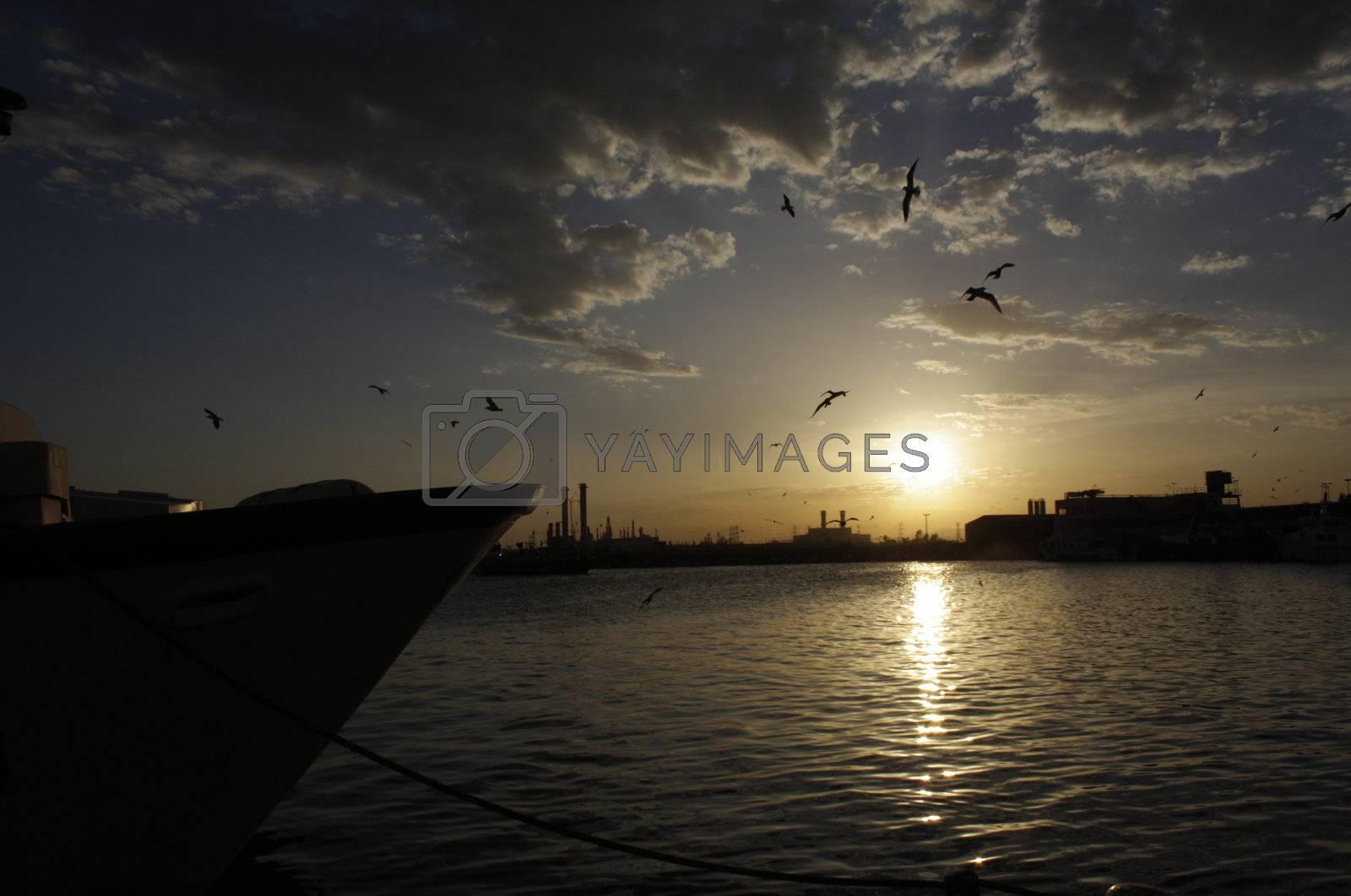 Beautiful sunset on Castellon Harbor, Mediterranean Sea, Spain.
