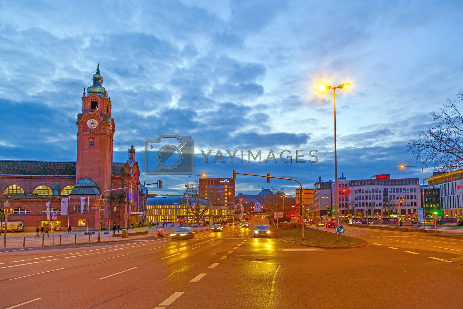 WIESBADEN, GERMANY JAN 12: evening traffic in front of the station on JAN 12,2013 in Wiesbaden , Germany. The  Railway Station, a prime example of Historicism, was dedicated on 13 November 1906.