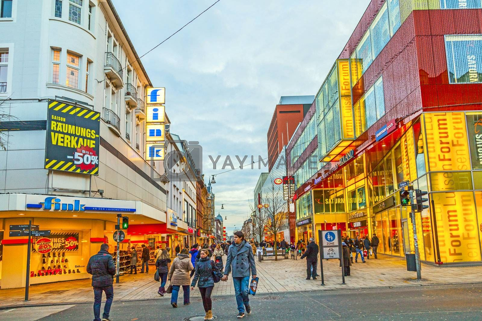 WIESBADEN, GERMANY JAN 12: people shop in the main pedestrian area on JAN 12,2013 in Wiesbaden , Germany. This shopping zone is a pedestrian area with a large variety shops sand stretches out for  one kilometer.