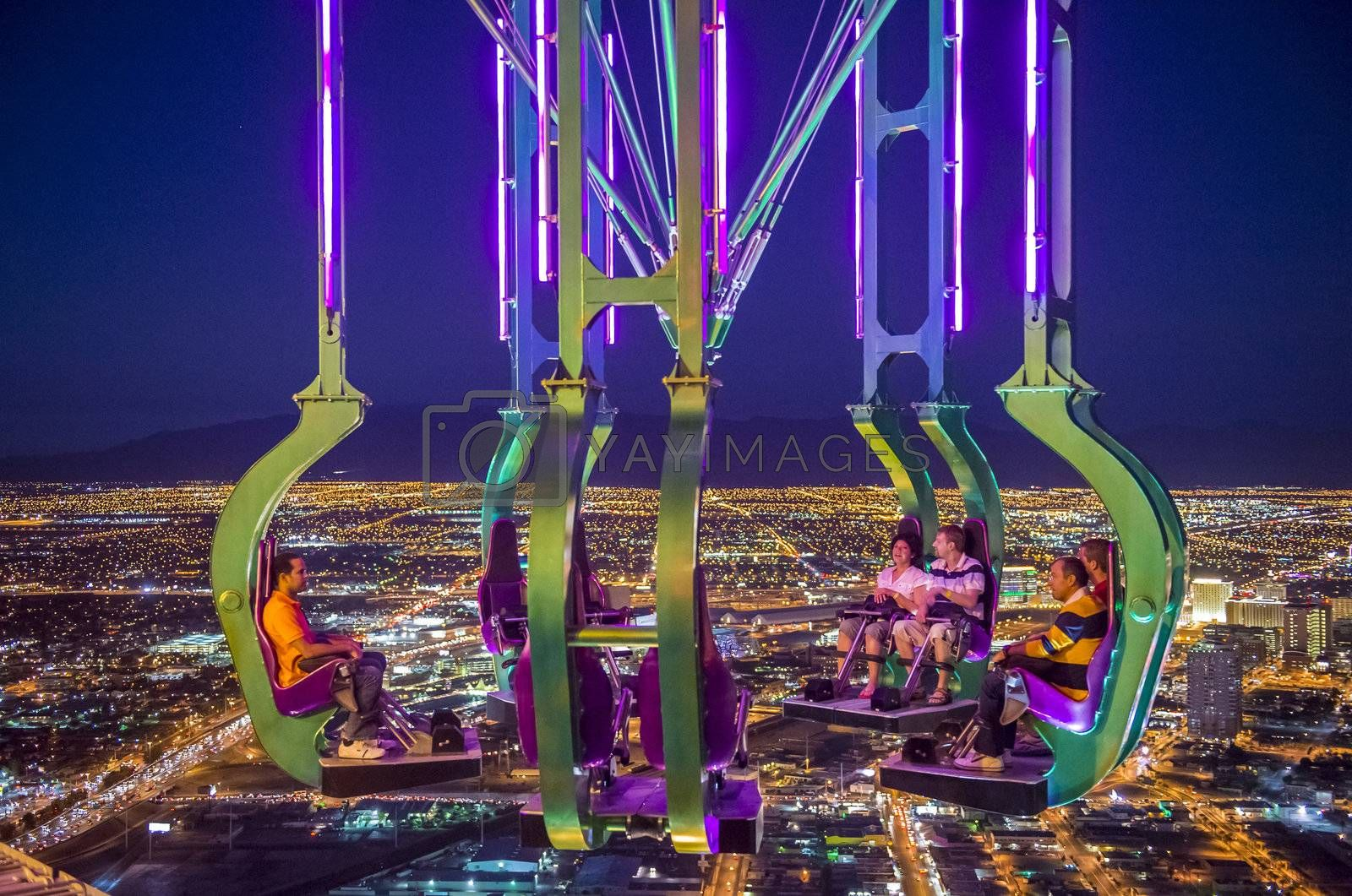 LAS VEGAS - NOVEMBER 08: The x-stream thrill ride on the top of Stratosphere tower on November 08, 2012 in Las Vegas. Las Vegas in 2012 is projected to break the all-time visitor volume record of 39-plus million visitors