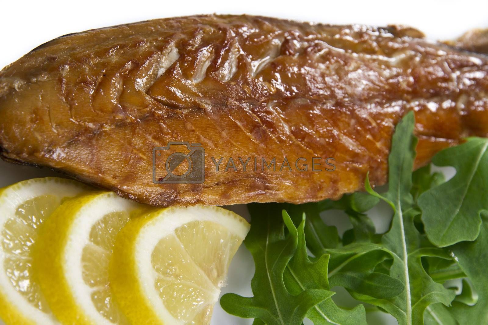 Smoked mackerel fish with lemon and salad