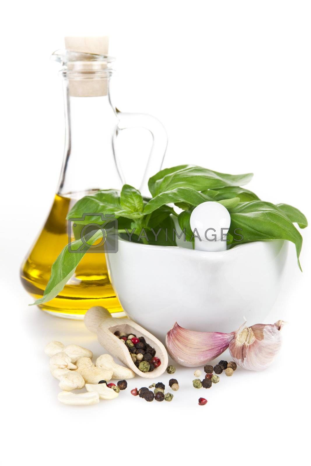 Pesto sauce ingredients over white backround