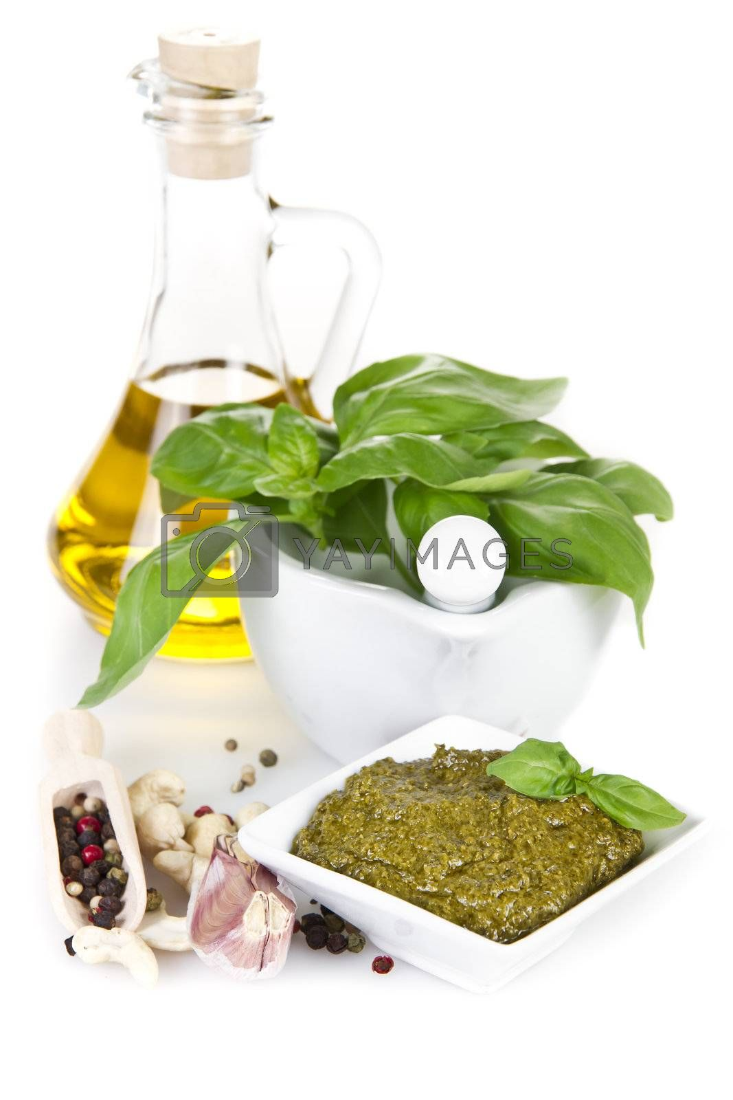 Pesto sauce with ingredients over white backround