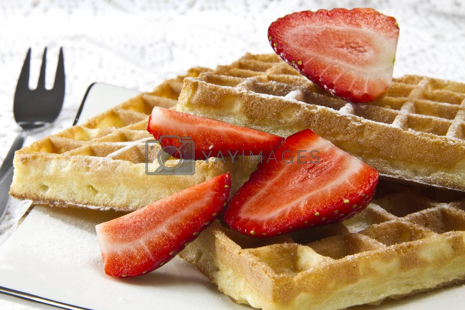 Freshly baked waffles with strawberries