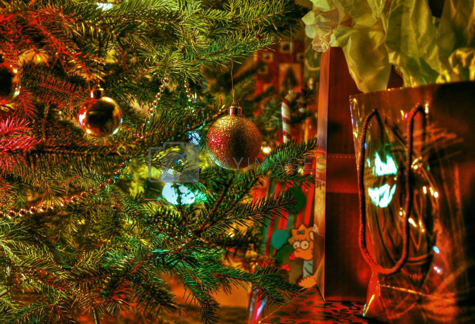 Wraped gifts under a Christmas tree and decorations