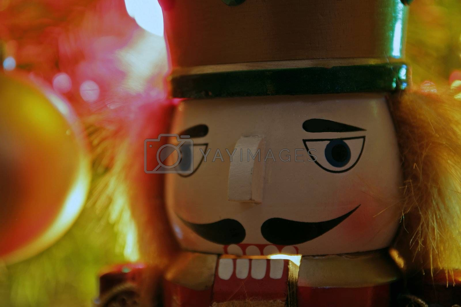 Close up view of Nutcracker in front of Christmas tree