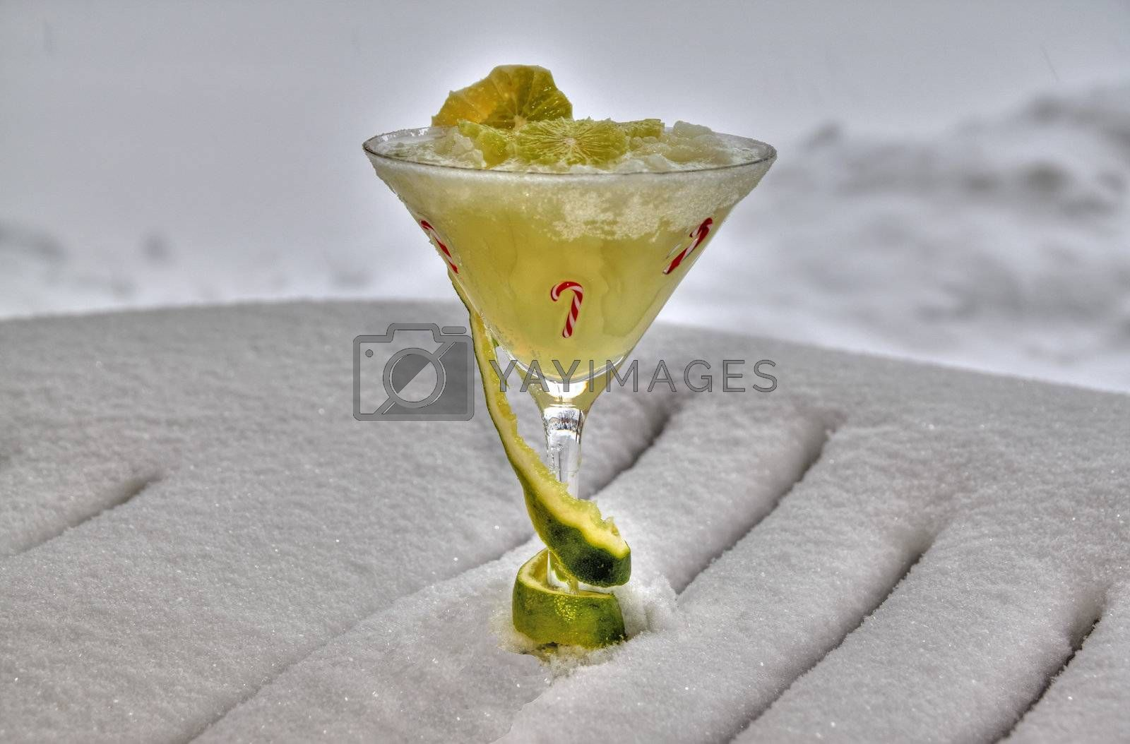 Decorated frozen marguerita drink on a bed of snow