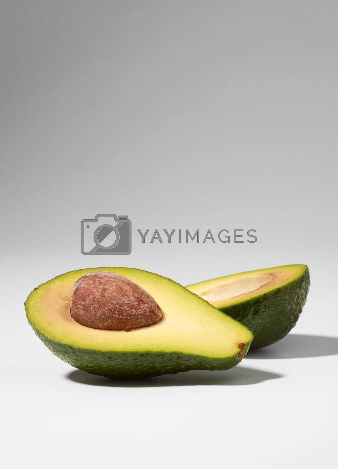 Close-up of cut avocado on white