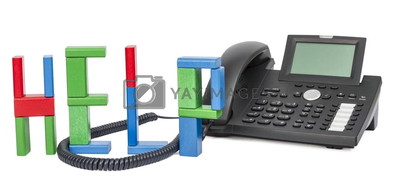 the word help made with toy bricks and a business phone in background.