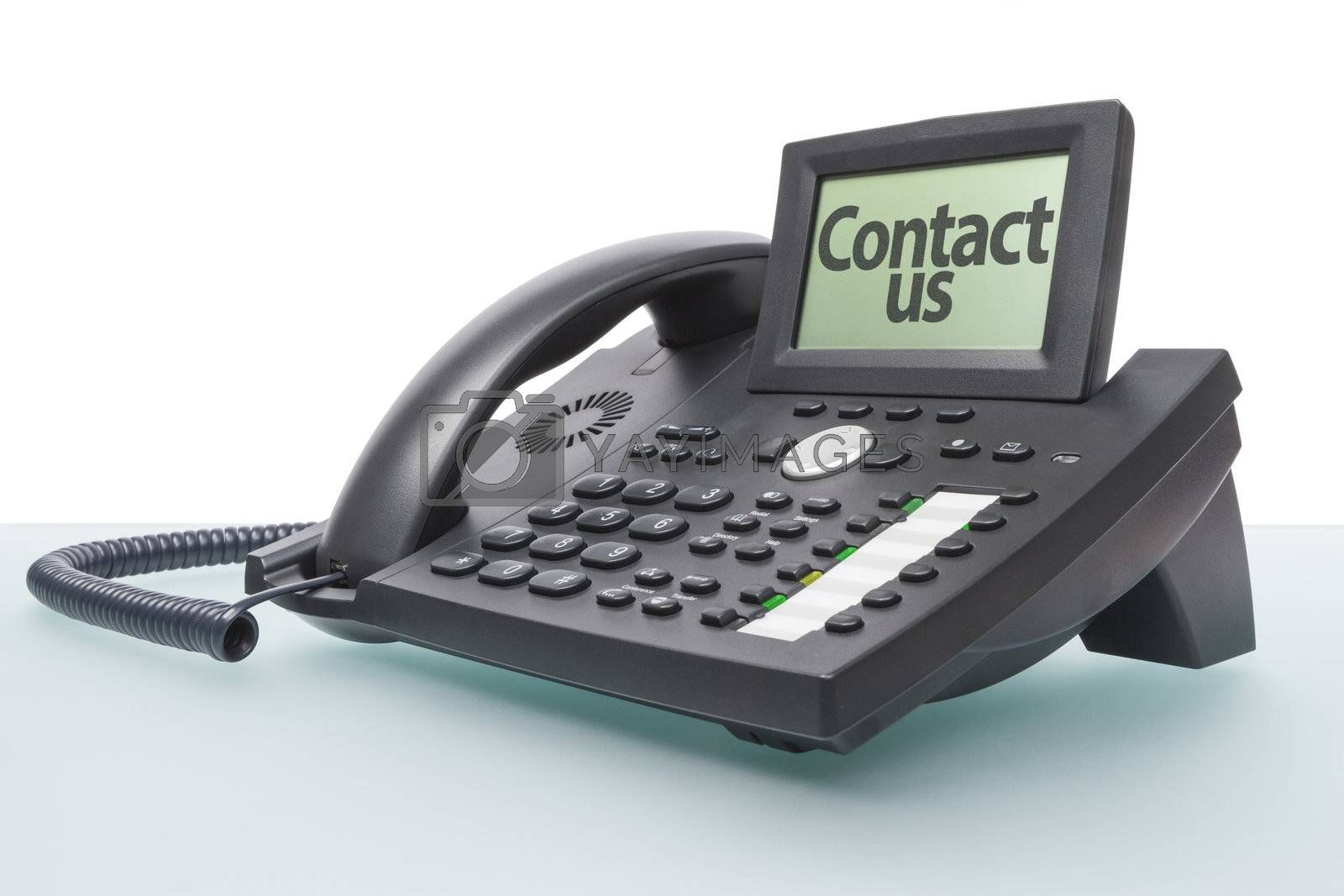 modern voip telephone on glas-topped desk saying CONTACT US