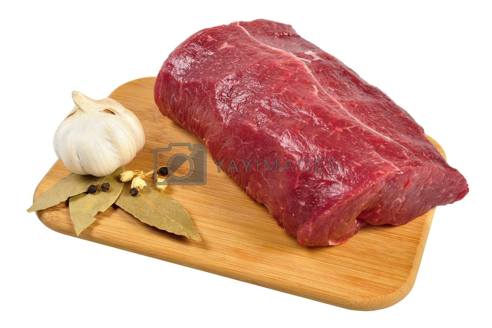 Royalty free image of Raw Beef on wooden board by grauvision