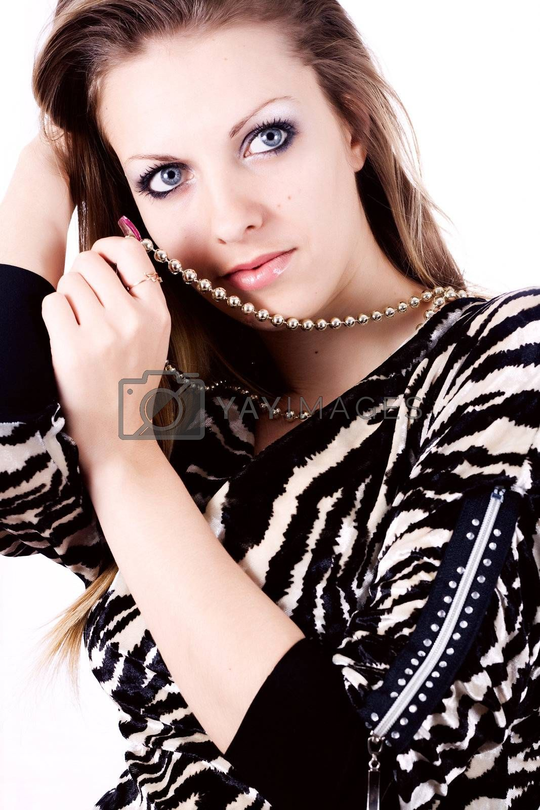 Ambition and greed in fashion woman with jewelry in hands on white background